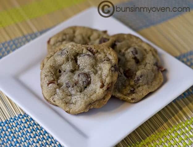 Three chocolate chip bacon cookies on a square plate