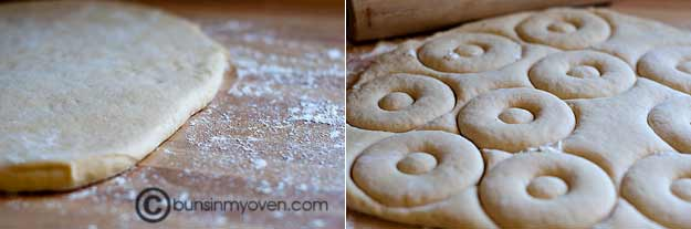 Dounut dough rolled out on a floured table