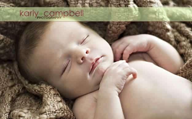 A close up of a sleeping newborn