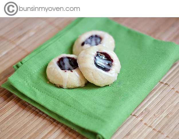 three thumb print cookies on a cloth napkin