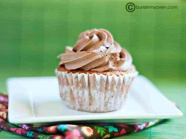A cupcake on a square white plate