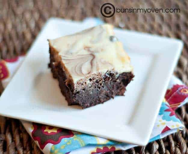 A cheesecake brownie on a square plate