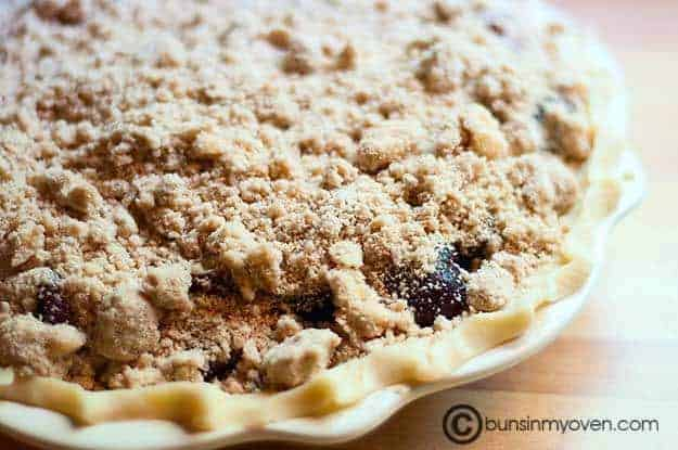 The closeup of cherry pie topped with streusel