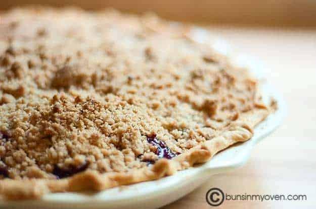 A closeup of cherry pie in a pie plate