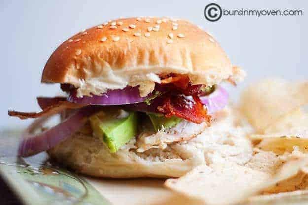 The chicken bacon avocado sandwich on a sesame seed bun