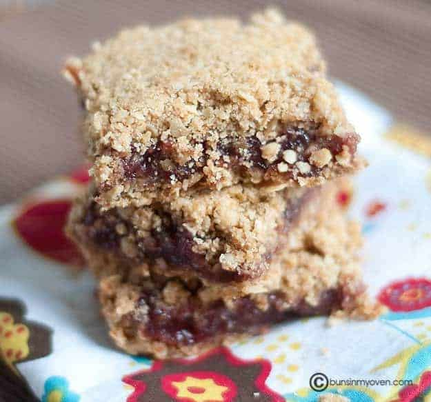 A close up of Three stacked raspberry oatmeal  bars