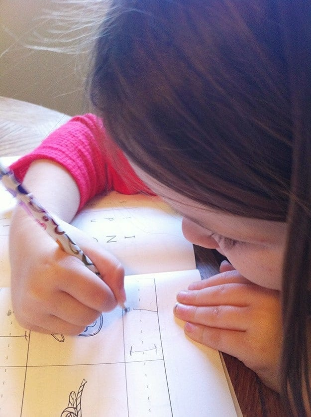 A close up of a girl doing school work.