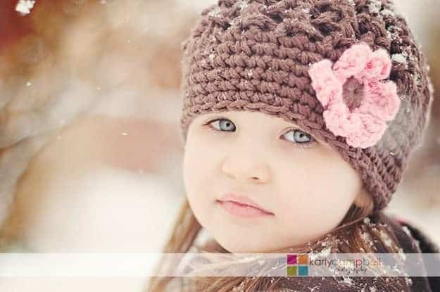 A close up of a girl in a winter hat