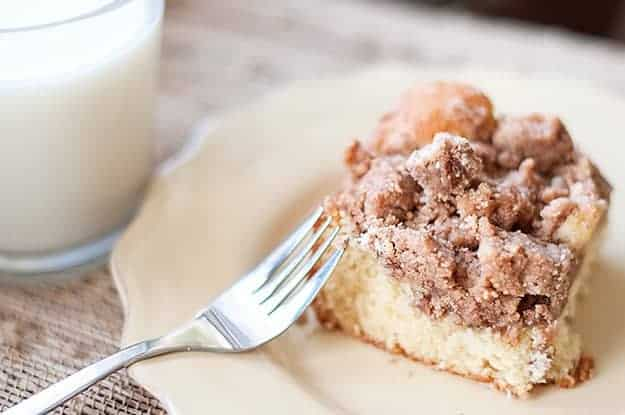 A piece of coffee cake on a plate with a fork