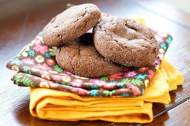 three cheesecake stuffed chocolate cookies on a couple of folded cloth napkins