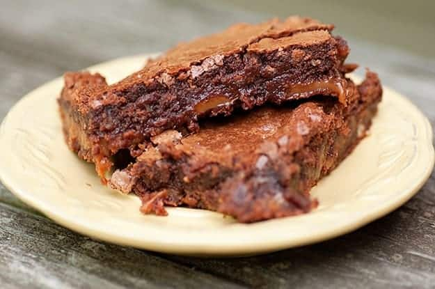 A close up of two turtle brownies on a plate