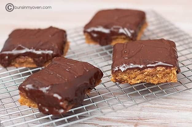 Chocolate peanut butter bars on drying rack.