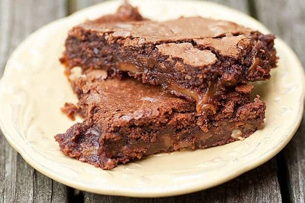Two turtle brownies on a round plate