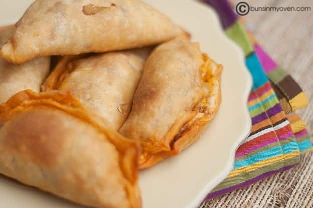 A perfectly executed empanada recipe served on a white platter.