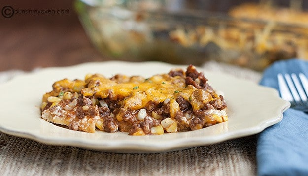 Side view of BBQ ground beef casserole on a white plate.