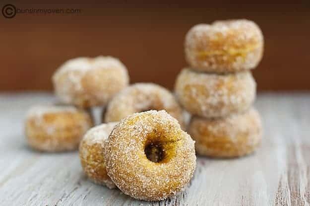 8 cinnamon sugar pumpkin donuts on a table