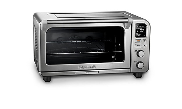 A toaster oven sitting on top of a stove