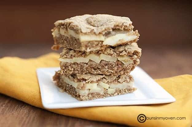 A stack of Appleseed bars on a square white plate.