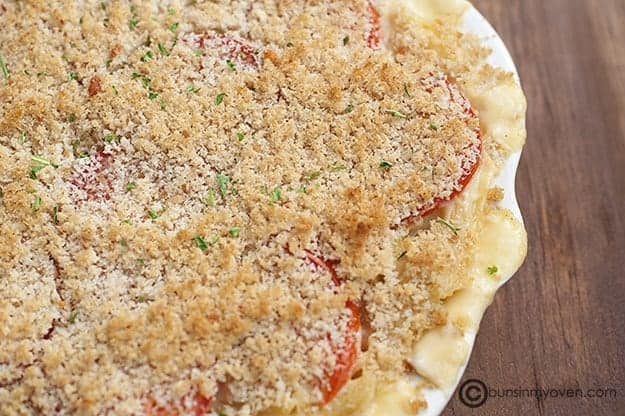 Creamy baked macaroni and cheese in a white pan.