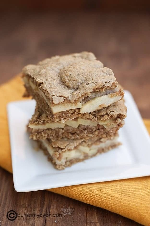 A close up of a stack of Appleseed bars on a square white plate.