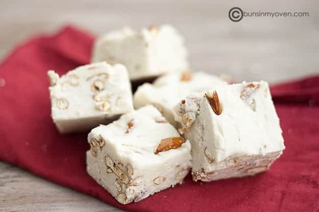 A few bits of white chocolate fudge on a red napkin