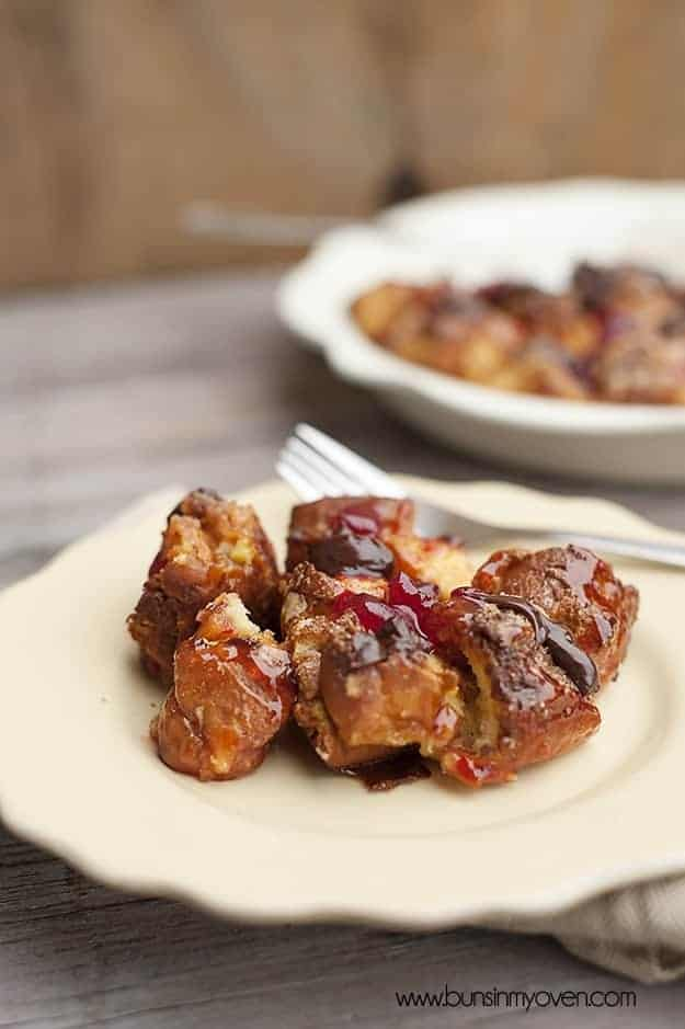 Yummy donut bread pudding with strawberry topping.