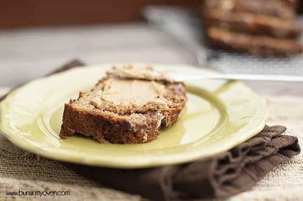 A slice of banana bread on a decorative plate.