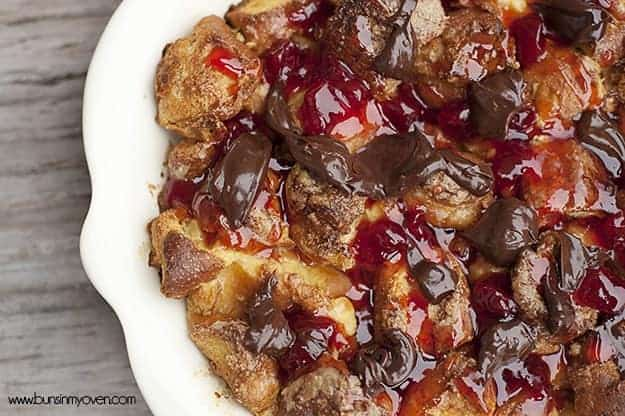 Strawberry donut bread pudding in a white dish.