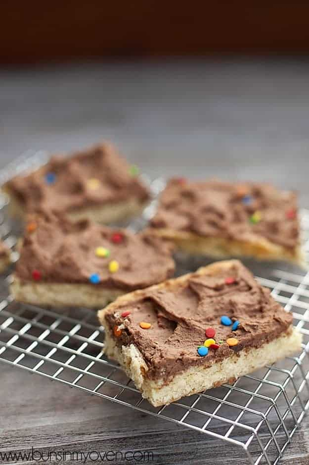 A closeup of a sugar cookie bar with chocolate frosting