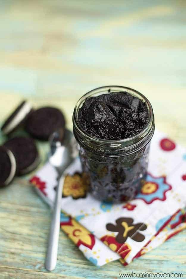 A clear glass jar of oreo cookie spread