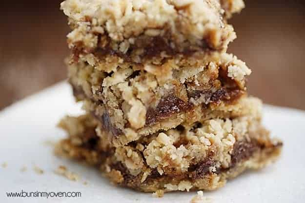 Close up picture of stacked oatmeal carmelitas.