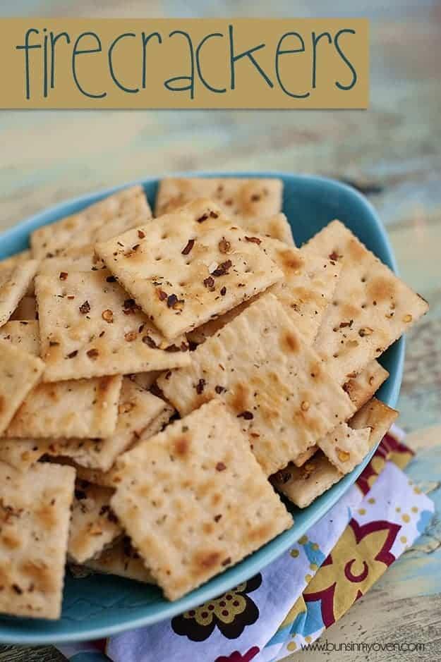 Firecracker crackers in a blue appetizer serving dish.