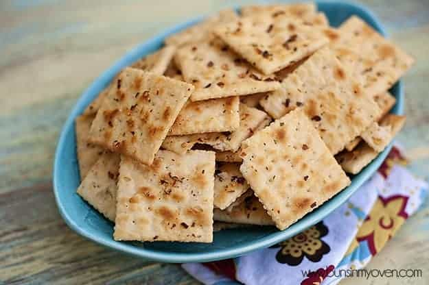Many seasoned saltine crackers on an appetizer serving dish
