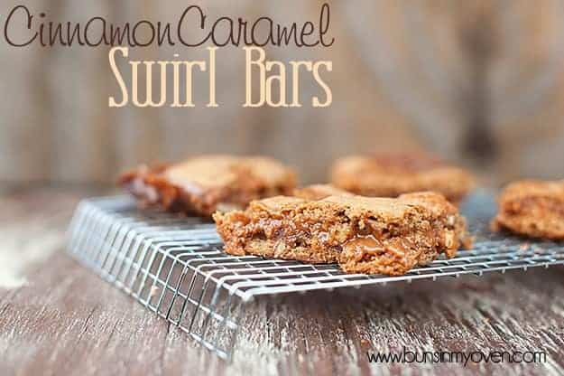 A close up of a few cinnamon caramel bars on a wire cooling rack