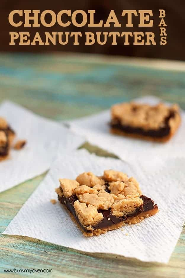 Three chocolate peanut butter bars on paper towels.