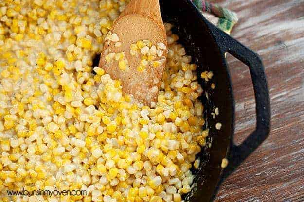 A close up of southern cream corn in a cast-iron skillet