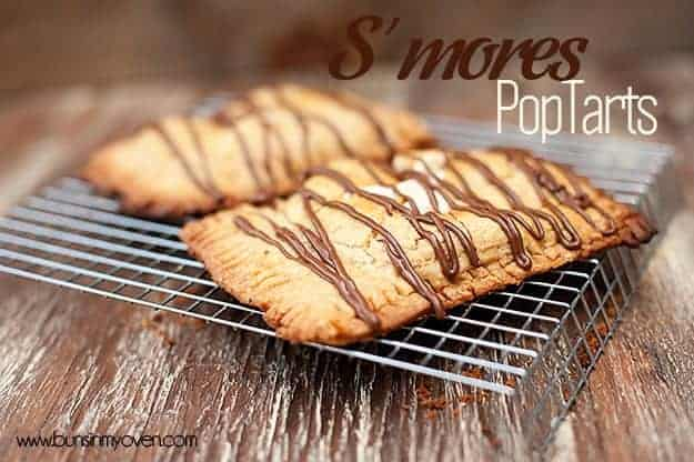 Two smores pop tarts resing on a wire cooling rack.
