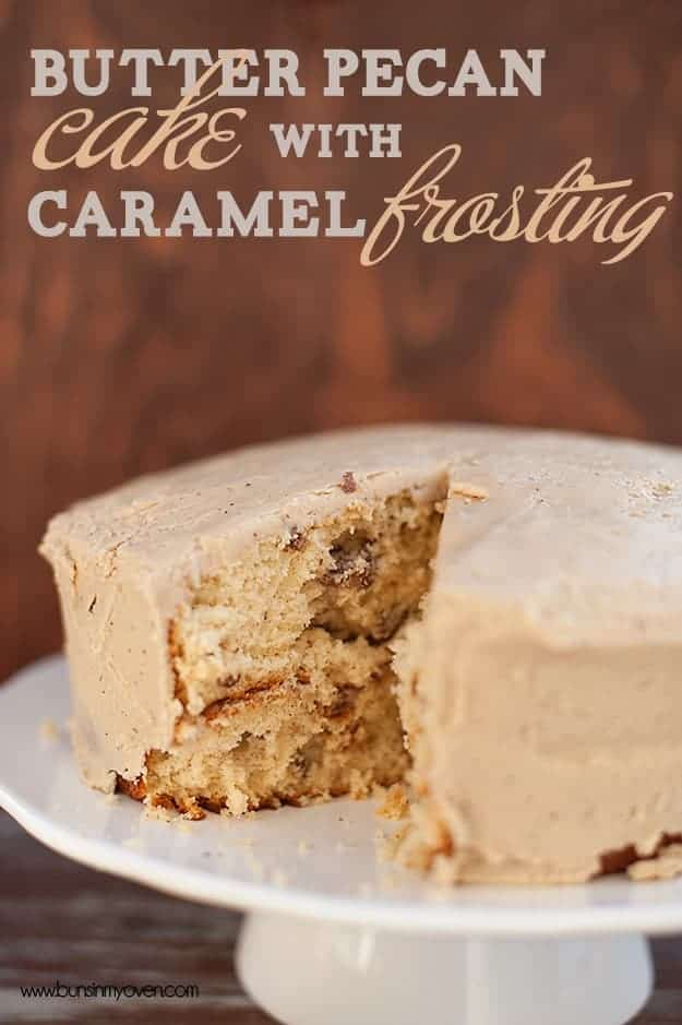 Butter pecan cake on a white cake stand