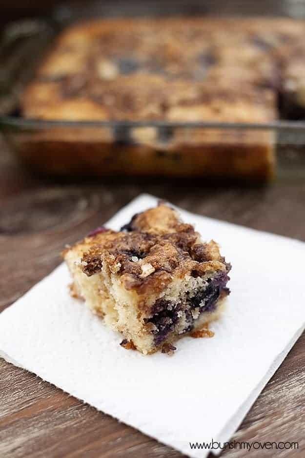 A square piece of blueberry honey bun cake on a napkin.
