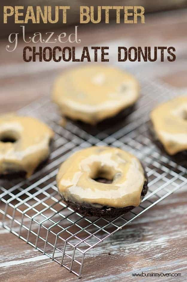 Chocolate donuts with peanut butter icing on a wire cooling rack.