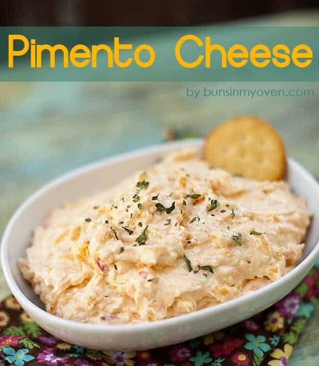 A pimento cheese dip in an oval bowl with a ritz cracker in it.