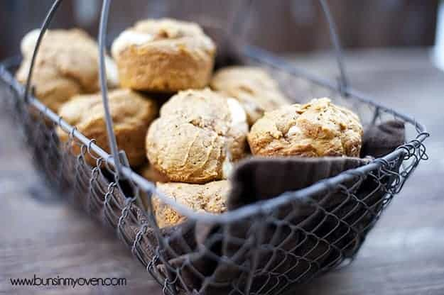 A wire basket full of pumpkin muffins.
