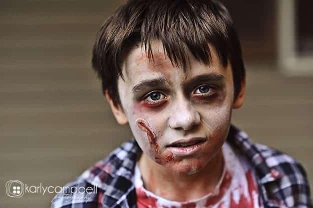 A boy dressed up as a zombie