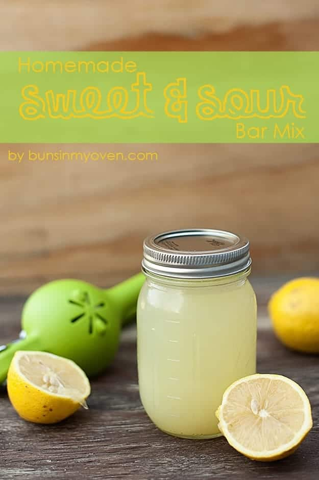 Lemon slices surrounding a jar of sweet and sour mix.